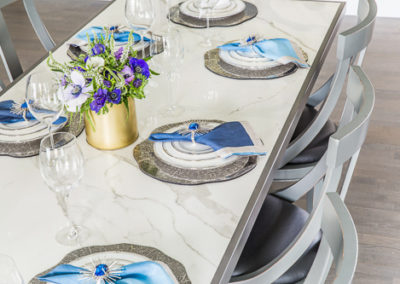 blue and silve place settings marble table