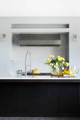white kitchen countertop with flowers